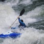 Kayaker paddling through water — Stock Photo