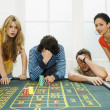 Friends losing on roulette table — Stock Photo