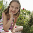 Young girl in meadow — Stock Photo