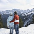 Couple looking at view from mountain — Stock Photo #33852959