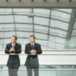 Stock Photo: Businessmen Leaning at Railing