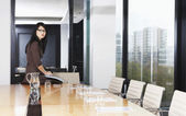 Business woman in boardroom — Stock Photo