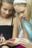 Girl applying nail polish — Stock Photo