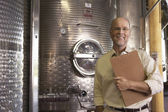 Winemaker with Wine Vats — Stock Photo