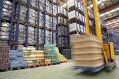 Speeding Forklift in Warehouse — Stock Photo
