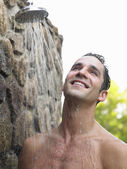 Mid adult man taking shower — Stock Photo