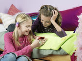 Girls looking at mobile phone — Stock Photo