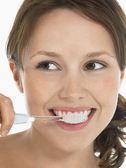 Young Woman Brushing Teeth — Stock Photo