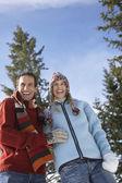 Couple standing on hillside — Stock Photo