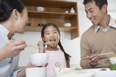 Couple and daughter eating a meal — Stock Photo