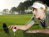 Golfer Placing Ball on Tee — Stock Photo