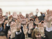Crowd of people raising hands — Stock Photo