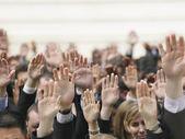 Crowd of people raising hands — Foto de Stock