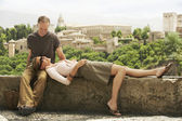 Couple Relaxing on Wall — Stock Photo