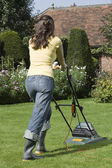 Woman Mowing Lawn — Stock Photo