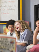 Schoolkids laughing — Stock Photo