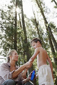 Mother Applying Suntan Lotion to Son — Stockfoto