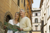 Couple with map — Stock Photo