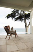 Woman Relaxing on Porch — Stock Photo