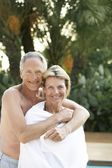 Senior Couple at Poolside — Stock Photo