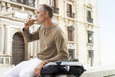 Tourist Drinking Latte — Stock Photo