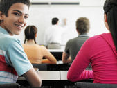 Students sitting in classroom — Stock Photo