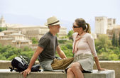 Tourist Couple Relaxing on Wall — Stock Photo