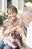 Grandparents playing with granddaughter — Fotografia Stock