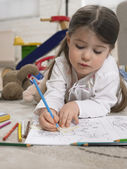 Girl with Coloring Book — Stock Photo