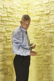 Businessman at Wall with Post Its — Stock Photo