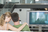Young couple watching TV — Stock Photo
