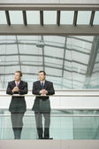 Businessmen Leaning at Railing — Stock Photo