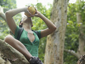 Woman drinking from coconut — Stock Photo