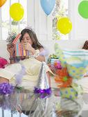Girl  opening birthday presents — Стоковое фото