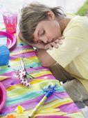 Boy sleeping at table — Stock Photo