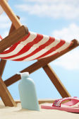 Cream lotion under deckchair — Stock Photo
