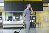 Man at Airport Using Cell Phone — Stock Photo