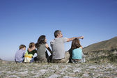Family Resting in Mountain Range — Stock Photo