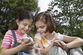 Girls with Jar Outside — Stock Photo