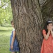 Girls Playing Hide-and-Seek — Stock Photo #33860037