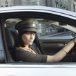 Female chauffeur in car — Stock Photo #33862915