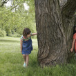 Girls Playing Hide-and-Seek — Stock Photo #33863947