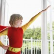Boy wearing superhero costume — Foto de Stock   #33865877