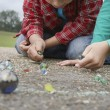 Boy and Girl Playing Marbles — Stock Photo #33866403