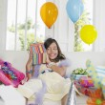 Girl opening birthday presents — Stock Photo #33868533