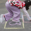 Girl Playing Hopscotch — Stock Photo #33869589