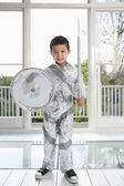 Boy in aluminum foil knight costume — Stock Photo
