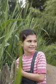 Girl standing beside reeds — Stock Photo