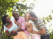 Two couples laughing — Stock Photo