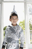 Boy wearing aluminum foil knight costume — Stock Photo